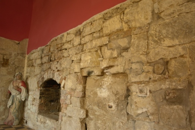 In the 15c. wall - a fragment of the 11c. arch
